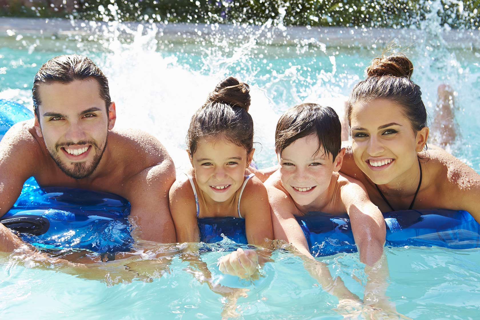 Happy family on swimming pool